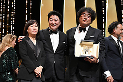 "Lee Jung-Eun, Kang-Ho Song and Director Bong Joon-Ho, winner of the Palme d'Or award for ""Parasite"" pose during the 72nd annual Cannes Film Festival on May 25, 2019 in Cannes, France.<br /> Photo by David Niviere/ABACAPRESS.COM"