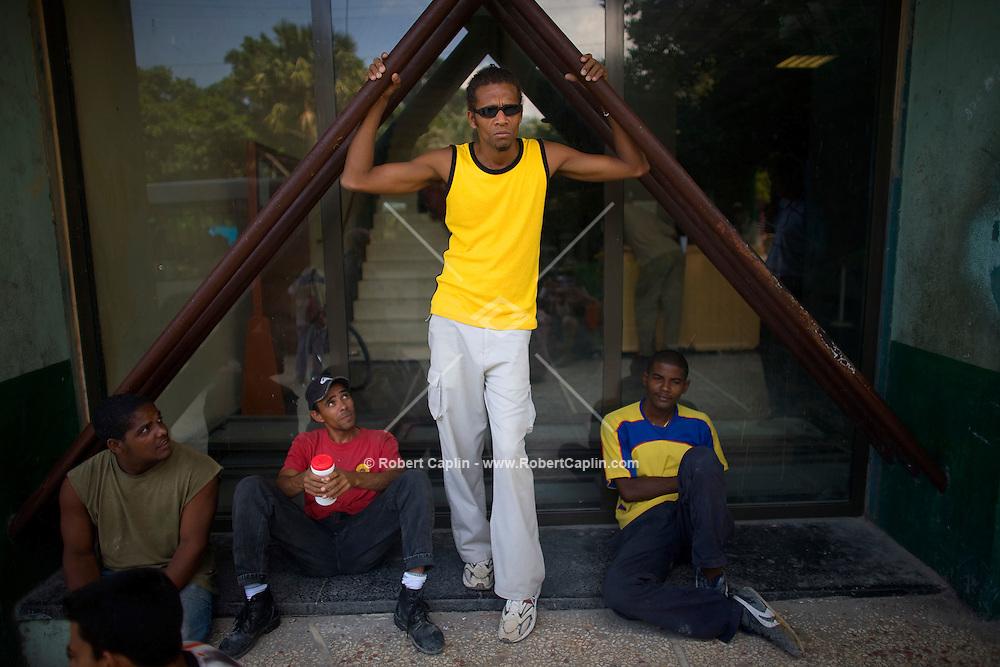 portrait of cuban men outside of building in havana, cuba
