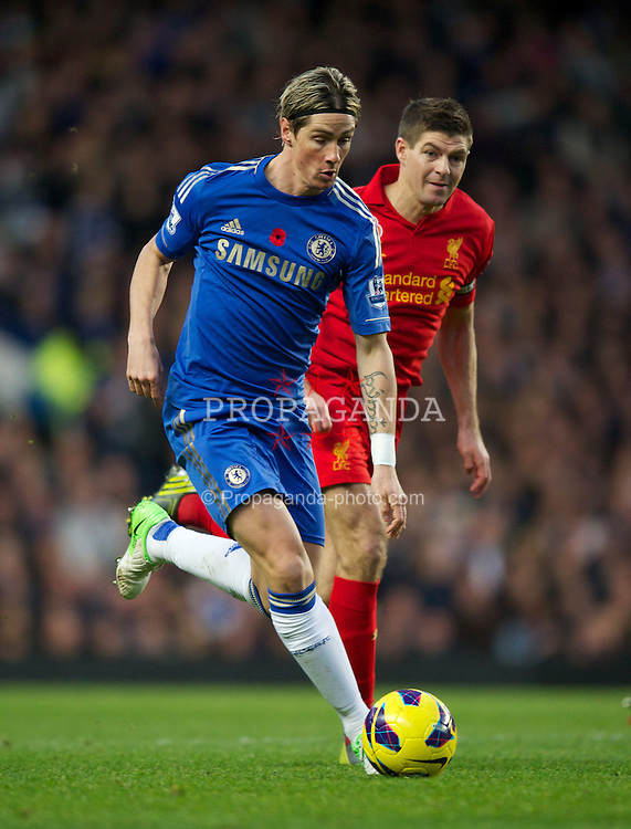 LONDON, ENGLAND - Sunday, November 11, 2012: Chelsea's Fernando Torres in action against Liverpool's captain Steven Gerrard during the Premiership match at Stamford Bridge. (Pic by David Rawcliffe/Propaganda)