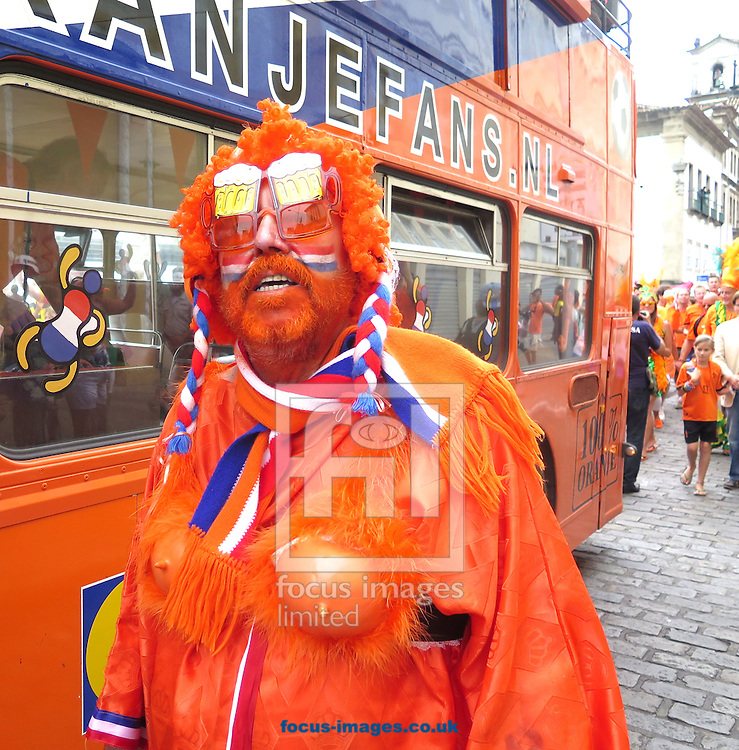 Fans of Netherlands arrive at the stadium prior to the 2014 FIFA World Cup match at the Itaipava Arena Fonte Nova, Nazare, Bahia<br /> Picture by Stefano Gnech/Focus Images Ltd +39 333 1641678<br /> 05/07/2014