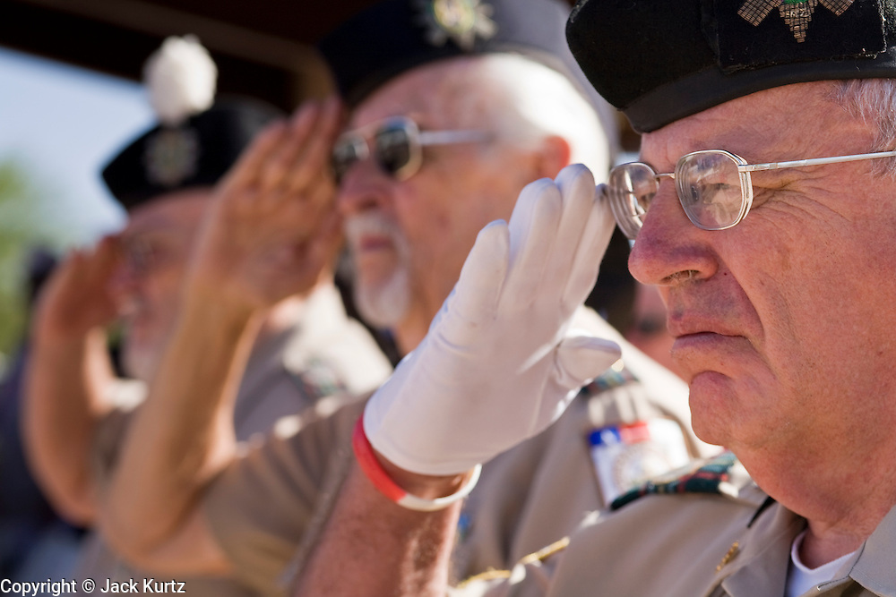 28 MAY 2007 -- PHOENIX, AZ: Members of the Scottish American Military Society salute the colors during the Memorial Day ceremony at the National Memorial Cemetery in Phoenix, AZ, Monday. There are more than 46,000 people buried in the National Memorial Cemetery in Phoenix.  Photo by Jack Kurtz/ZUMA Press