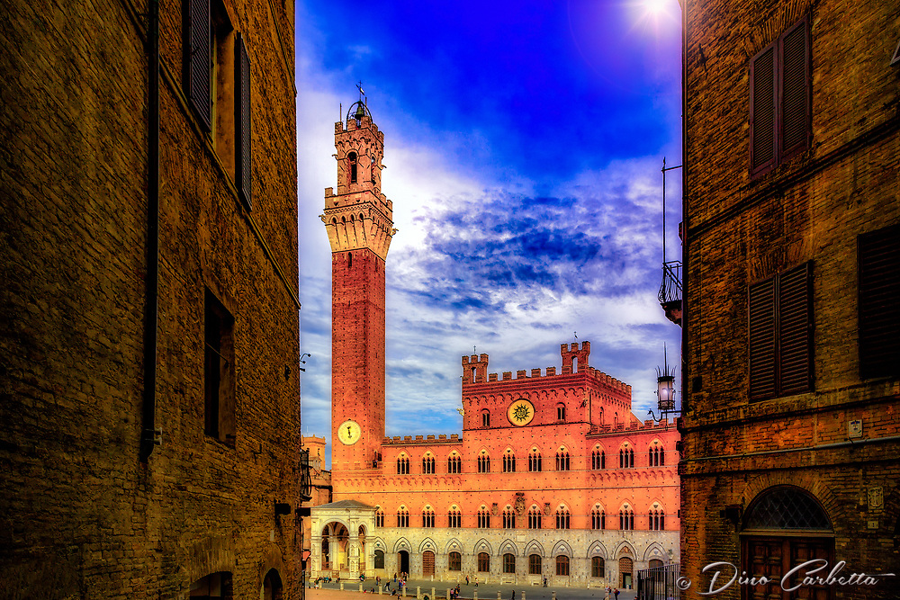 """The sunset begins over Torre del Mangia in Piazza del Campo di Siena""...<br />