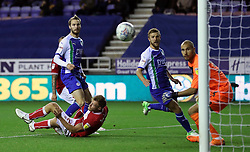 Wigan Athletic's Nick Powell (left) scores his side's first goal of the game during the Sky Bet Championship match at the DW Stadium, Wigan.