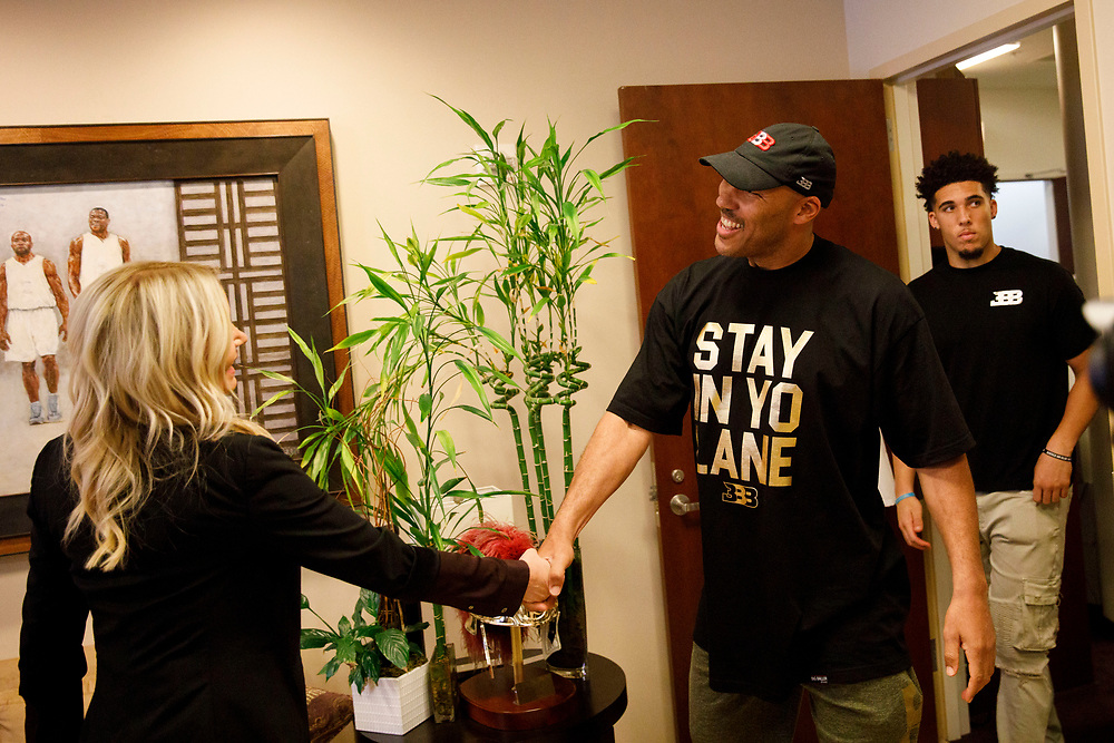 LaVar Ball shakes hands with Lakers President Jeanie Buss in her office at the Lakers' Practice Facility on Friday, June 23, 2017 in El Segundo, California. The Lakers selected Lonzo Ball as the No. 2 overall NBA draft pick and is the son of LaVar Ball. Pictured in rear is son LiAngelo Ball. © 2017 Patrick T. Fallon