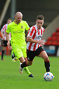 Billy Waters and Gary Jones during the Vanarama National League match between Cheltenham Town and Southport at Whaddon Road, Cheltenham, England on 15 August 2015. Photo by Antony Thompson.