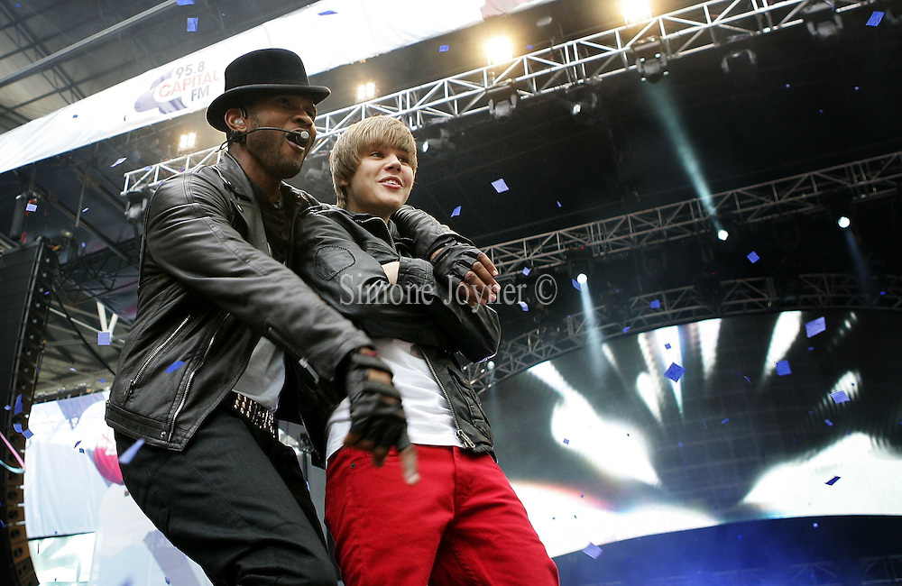Usher and Justin Bieber during the 'Capital Radio Summertime Ball' at Wembley Stadium on June 6, 2010 in London, England.  (Photo by Simone Joyner)