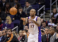Jan. 14, 2013; Phoenix, AZ, USA; Phoenix Suns forward P.J. Tucker (17) passes the ball during the game against the Oklahoma City Thunder at the US Airways Center. The Thunder defeated the Suns 102-90. Mandatory Credit: Jennifer Stewart-USA TODAY Sports