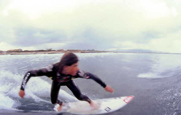 Roberto D'Amico, one of the italian surfer sponsored by Quicksilver, surf a wave in Sardegna. Spring swell, La Punta spot.