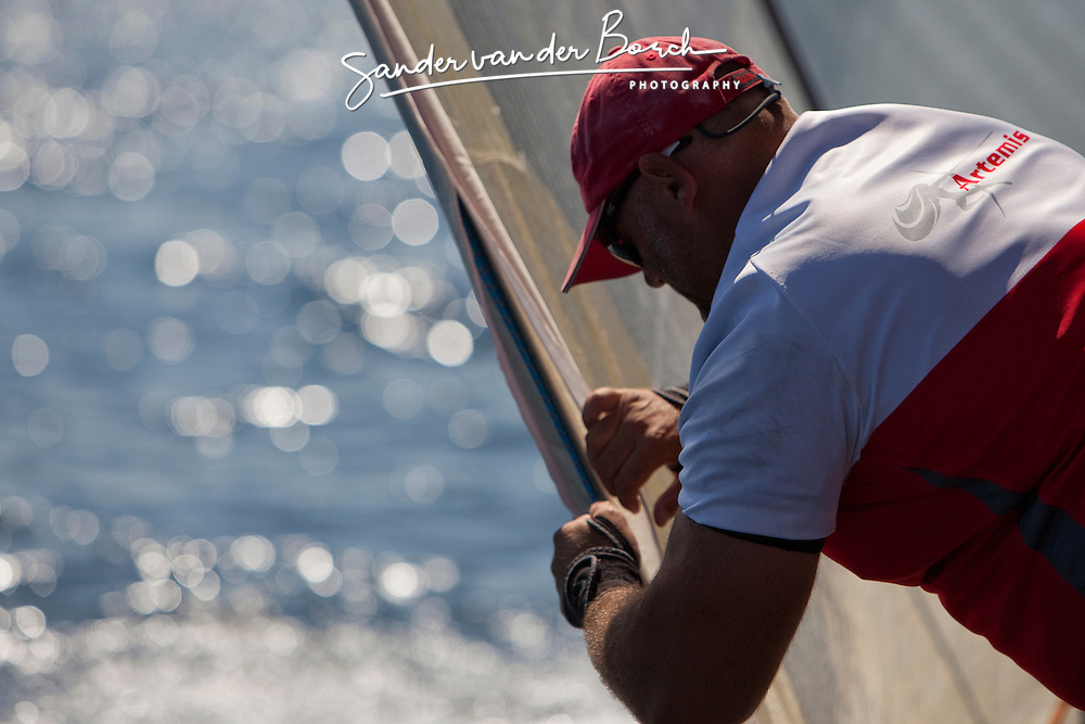 Craig Monk tightening the leach line. Semi-final Artemis (SWE) vs Emirates Team New Zealand (NZL.  La Maddalena, Sardinia, June 4th 2010. Louis Vuitton Trophy  La Maddalena (22 May -6 June 2010) © Sander van der Borch / Artemis