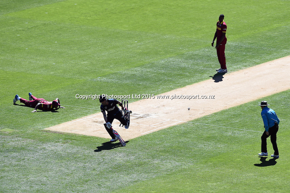 New Zealand captain Brendon McCullum makes his ground during a tight single during the ICC Cricket World Cup Quaterfinal match between New Zealand and West Indies at Westpac Stadium in Wellington, New Zealand. Saturday 21  March 2015. Copyright Photo: Raghavan Venugopal / www.photosport.co.nz