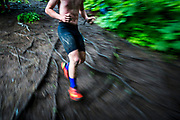 Wet roots and slick mud pose an extra hurdle for racers as they weave through narrow paths.