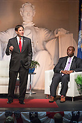 Senator and GOP presidential candidate Marco Rubio gives opening remarks during Tim's Presidential Town Hall meeting as Sen. Tim Scott looks on August 7, 2015 in North Charleston, SC.