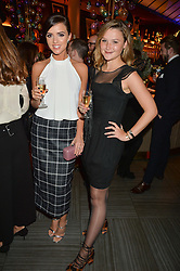 Left to right, LUCY MECKLENBURGH and AMBER ATHERTON at the fourth annual Fayre of St James's charity Christmas concert hosted by the Quintessentially Foundation and The Crown Estate in partnership with Deutsche Asset & Wealth Management held at  St James's Church, 197 Piccadilly, London followed by a party at Quaglino's 16 Bury Street, London on 24th November 2015.