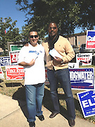 School Improvement Officer Justin Fuentes and Chief High Schools Officer Orlando Riddick volunteer at the polls.<br />