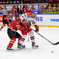 WHITBY, - Dec 16, 2015 -  Game #8 - Czech Republic vs. Canada East at the 2015 World Junior A Challenge at the Iroquois Park Recreation Complex, ON.  Owen Grant #2 of Team Canada East tries to tie up Tomas Psenicka #13 of Team Czech Republic during the first period.<br /> (Photo: Shawn Muir / OJHL Images)