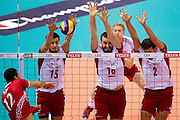 (L-R) Lukasz Zygadlo and Marcin Mozdzonek and Michal Winiarski all from Poland blok against Emre Batur from Turkey during the 2013 CEV VELUX Volleyball European Championship match between Poland and Turkey at Ergo Arena in Gdansk on September 20, 2013.<br /> <br /> Poland, Gdansk, September 20, 2013<br /> <br /> Picture also available in RAW (NEF) or TIFF format on special request.<br /> <br /> For editorial use only. Any commercial or promotional use requires permission.<br /> <br /> Mandatory credit:<br /> Photo by &copy; Adam Nurkiewicz / Mediasport