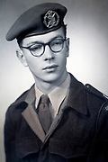 studio portrait of a young man in military uniform Nederlands 1950s