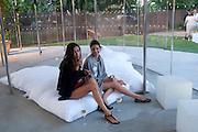 SASHA VOLKOVA; ( RED)  EVGENIA SLYNSARENKO, 2009 Serpentine Gallery Summer party. Sponsored by Canvas TV. Serpentine Gallery Pavilion designed by Kazuyo Sejima and Ryue Nishizawa of SANAA. Kensington Gdns. London. 9 July 2009.