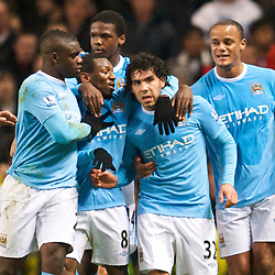 MANCHESTER, ENGLAND - Tuesday, January 19, 2010: Manchester City's Carlos Tevez celebrates scoring the equalising goal from the penalty spot against Manchester United during the Football League Cup Semi-Final 1st Leg at the City of Manchester Stadium. (Photo by David Rawcliffe/Propaganda)