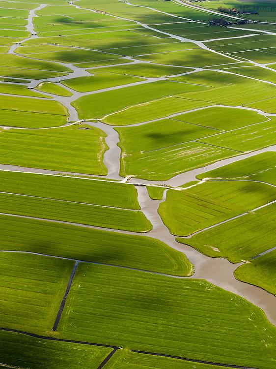 Nederland, Noord-Holland, Gemeente Schermer, 16-04-2012; Polder Mijzen met riviertjes en sloten. De polder is een aardkundig monument doordat het laagveen (mosveen) nagenoeg onaangetast is. .Polder Mijzen, a geological monument, the bog (moss) is virtually untouched.luchtfoto (toeslag), aerial photo (additional fee required);.copyright foto/photo Siebe Swart