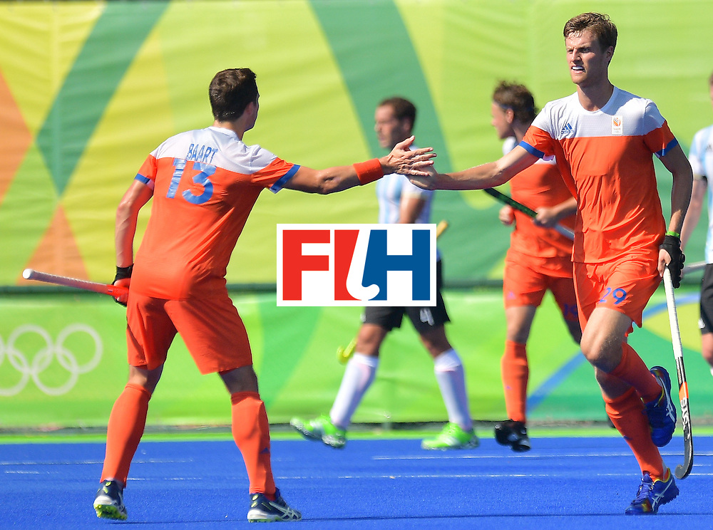 The Netherlands Hidde Turkstra (R) celebrates with Sander Baart during the men's field hockey Argentina vs Netherlands match of the Rio 2016 Olympics Games at the Olympic Hockey Centre in Rio de Janeiro on August, 6 2016. / AFP / Carl DE SOUZA        (Photo credit should read CARL DE SOUZA/AFP/Getty Images)