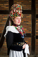 Celine, member of the 'Original Schee&szlig;eler Trachtengruppe e.V.' is wearing an original traditional bridal costume in Schee&szlig;el, Lower Saxony, Germany on November 13, 2016.<br /> <br /> The jewelry and crown is from the time between 1830 and 1870.<br /> Only pristine women were allowed to wear the bridal crown.<br /> <br /> This is part of the series about Traditional Wedding Gowns from different regions of Germany, worn by young members of local dance groups and cultural associations that exist to preserve and celebrate the cultural heritage. The portraiture series is a depiction of an old era with different social values and religious beliefs in an antiquated civil society with very few of those dresses left.