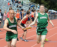 Pennridge's Jeff Espinal (left) receives a handoff from Matt Eissler in the 4 x800 relay during the Central Bucks West Relays at Central Bucks West High School Saturday April 23, 2016 in Doylestown, Pennsylvania. (Photo by William Thomas Cain)