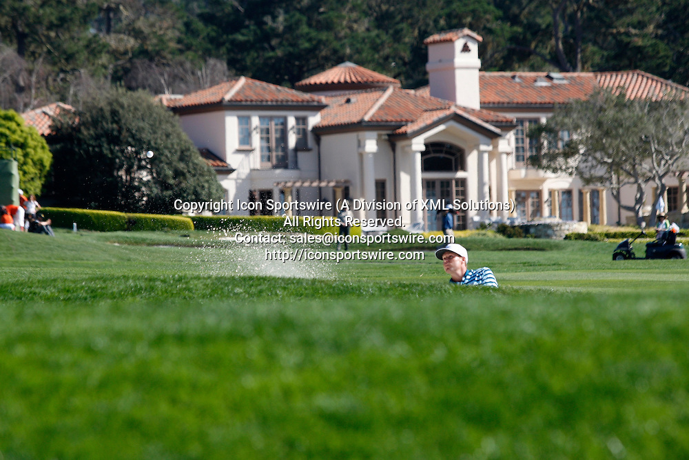 Feb 15 2015: Nick Watney blasts out of a fairway bunker on the 14th during the final round of the AT&T Pebble Beach National Pro-Am in Pebble Beach, CA.