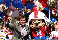 Feb 8, 2010;  Lake Buena Vista, FL, USA; Fans of New Orleans Saints quarterback and Super Bowl XLIV MVP Drew Brees partake in festivities of the ticker-tape parade on Main Street at Walt Disney World's Magic Kingdom.