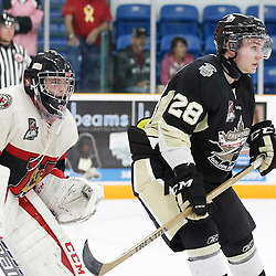 TRENTON, ON - SEP 8:  Lucas Brown #28 of the Trenton Golden Hawks attempts to screen goaltender Jesse Hodgson #31 of the Newmarket Hurricanes during the OJHL regular season game between the Newmarket Hurricanes and Trenton Golden Hawks on September 8, 2016 in Trenton, Ontario. (Photo by Amy Deroche/OJHL Images)