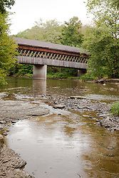"State Road Bridge, built in 1983 of 97,000 feet of southern pine and oak, was erected in 1983 across Conneaut Creek, Ashtabula county, Ohio.  It is 152-feet-long in a style known as ""Town Lattice."""