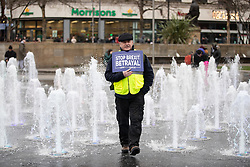 "© Licensed to London News Pictures . 05/01/2019. Manchester, UK. A man holds a "" Stop Brexit Betrayal "" placard in the fountains at Piccadilly Gardens . A Yellow Vest demonstration takes place in St Peter's Square in central Manchester . The protest was organised via YouTube account "" Tommy Robinson News "" and was called in the wake of stabbings at Manchester Victoria Train Station on New Year's Eve . Protesters chanted in favour of Brexit , against police and press and carried pro-Trump and EDL clothing and placards . Photo credit : Joel Goodman/LNP"