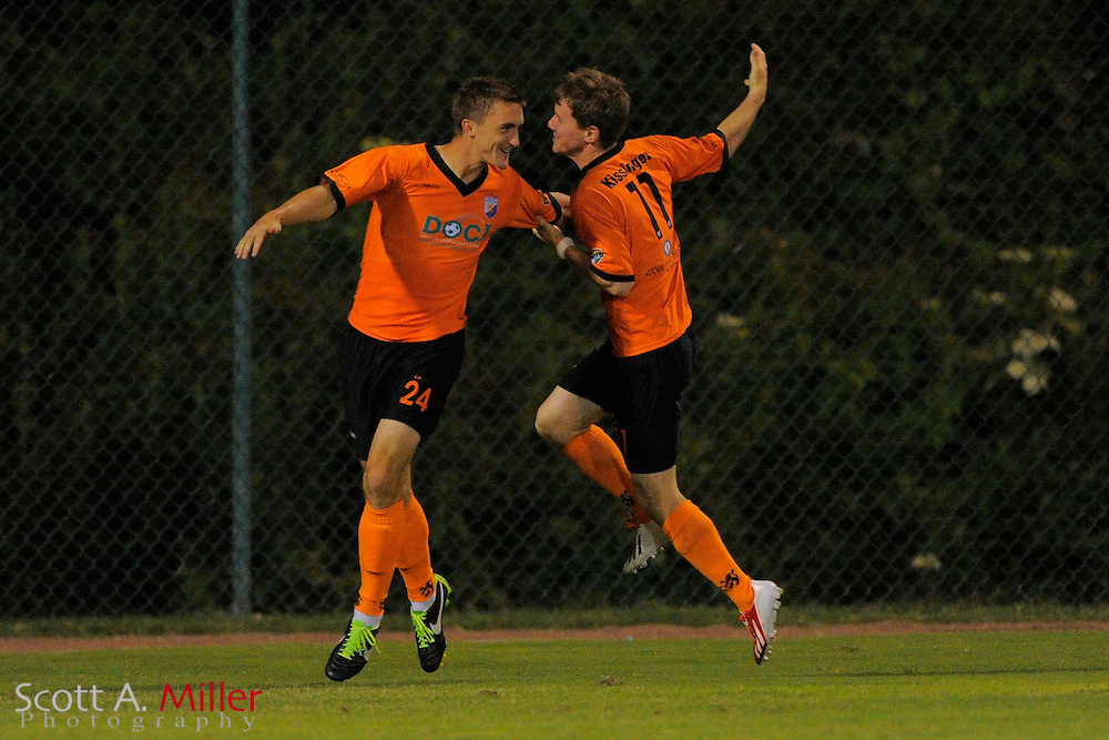 Dayton Dutch Lions forward Brandon Swartzendruber (24) celebrates his goal with forward Eric Kissinger (11) during a USL-Pro soccer game at the Plant City Stadium in Plant City, Florida April 26, 2013. Dayton won 1-0....©2013 Scott A. Miller