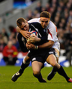 Twickenham, GREAT BRITAIN, Joe WORSLEY geting to grips, during the  England vs Scotland, Calcutta Cup Rugby match played at the  RFU Twickenham Stadium on Sat 03.02.2007  [Photo, Peter Spurrier/Intersport-images].....