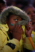 Nervous Bafan fan can't watch as Mexico equalise. Bafana Bafana fans gather to watch the opening match of the world cup between South Africa and Mexico. FIFA fan park. Sandton. Northern Johannesburg. South Africa. June 11th 2010..Picture by Zute Lightfoot