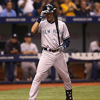 New York Yankees shortstop Derek Jeter (2) tips his helmet at the plate during a major league baseball game between the New York Yankees and the Tampa Bay Rays at Tropicana Field on Thursday, Sept. 17, 2014 in St. Petersburg, Florida. The Yankees won the game 3-2 and this was Jeter's last game against Tampa Bay. (AP Photo/Alex Menendez)