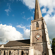 Side view of the Parish Church of St Mary in Painswick, Gloucestershire, in England's Cotswolds region.
