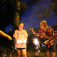 RAY VAN DUSEN/BUY AT PHOTOS.MONROECOUNTYJOURNAL.COM<br /> From left, Bella Nash-Johnson, Haley Baker, Kelly Nash-Johnson and Leigh Anna Jones set off sparklers with Cason Nash-Johnson, not pictured, left over from the Fourth of July recently at Morgan's Landing. The Aberdeen campground's popularity has increased through new management, extra security and grounds improvements.
