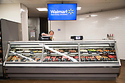 ROGERS, AR - OCTOBER 12:  Associate cleans the counter at the Meat Department at Walmart Store #4208 on October 12, 2015 in Rogers, Arkansas.  <br /> CREDIT Wesley Hitt for Wall Street Journal<br /> WALSQUEEZE