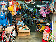 15 NOVEMBER 2016 - GEORGE TOWN, PENANG, MALAYSIA: A worker in a toy store on Kimberly Street in George Town, Penang, Malaysia. George Town is a UNESCO World Heritage city and wrestles with maintaining its traditional lifestyle and mass tourism.           PHOTO BY JACK KURTZ