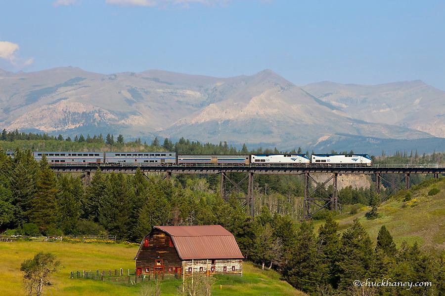 AMTRAK passenger train crosses the trestle over the Two Medicine River in East Glacier Montana