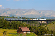 AMTRAK passenger train crosses the trestle over the Two Medicine River in East Glacier Montana