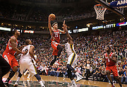 Rockets forward Chandler Parsons (25) goes up for a layup on Jazz forward Paul Millsap (24) during the second half of the NBA game between the Jazz and the Houston Rockets, Monday, Nov. 19, 2012.