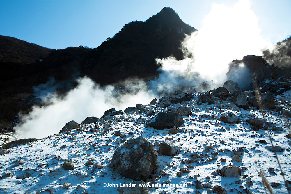 """Steam rising from vapours at one of the """"hells"""" of Japan - Owakudani at Hakone National Park.  The source of much of the hot water action in Hakone, the water bubbles out at 80 degrees Celcius."""