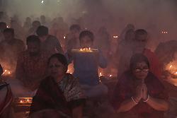 November 3, 2018 - Narayangonj, Bangladesh - Hindu devotees react as they sit together on the floor of a temple to observe Rakher Upabash in Narayangonj near Dhaka on November 2, 2018. (Credit Image: © Kazi Salahuddin Razu/NurPhoto via ZUMA Press)