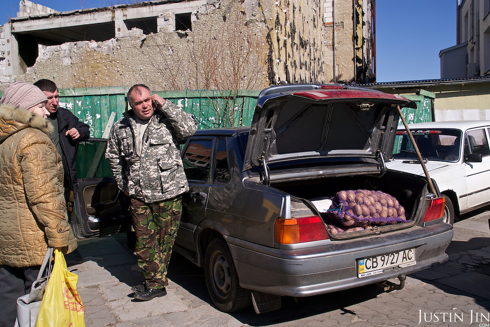 People sell potatoes in the town of Slavutych, which has some of the highest birth rates in Ukraine. <br /> <br /> Slavutych rises out of the ashes of the Chernobyl nuclear disaster in April 26, 1986. People living near the disaster area were largely moved to the new city, built from scratch for the sole purpose of housing the population displaced by the nuclear accident.