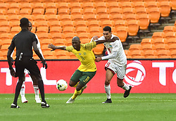 South Africa: Johannesburg: Bafana Bafana player Aubrey Modiba battle for the ball with Seychelles player Karl Hopprich during the Africa Cup Of Nations qualifiers at FNB stadium, Gauteng.<br />