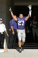 MANHATTAN, KS - NOVEMBER 17:  Wide receiver Jordy Nelson #27 of the Kansas State Wildcats walks out onto the field as he is announced to the crowd on Senior Day against the Missouri Tigers on November 17, 2007 at Bill Snyder Stadium in Manhattan, Kansas.  Missouri won the game 49-32.  (Photo by Peter Aiken/Getty Images)