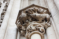 stone details on the front of the cathedral in sevilla, spain