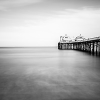 Malibu Pier black and white photo in Malibu California. Malibu is a beach city along the Pacific Ocean in Southern California in the United States.